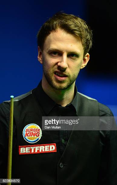 Judd Trump of England reacts during his first round match against Liang Wenbo of China on day six of the World Snooker Championship at The Crucible...