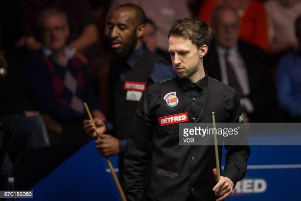 Judd Trump of England reacts during his first round match against Rory McLeod of England on day five of Betfred World Championship 2017 at Crucible...