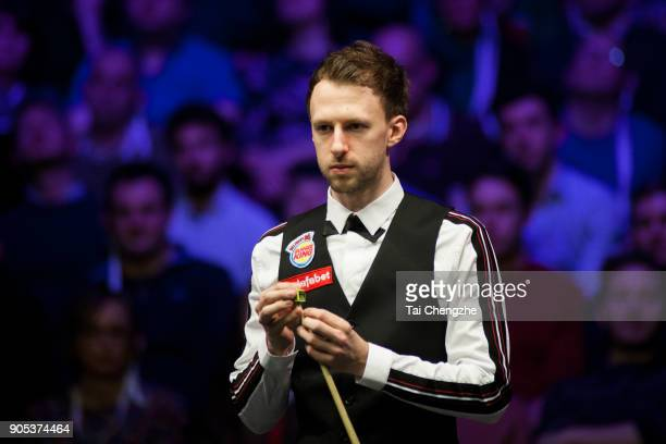 Judd Trump of England reacts during his first round match against Liang Wenbo of China on day two of The Dafabet Masters at Alexandra Palace on...