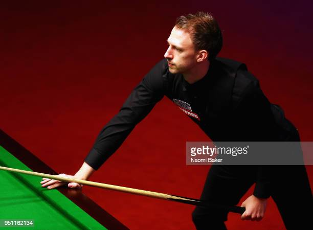 Judd Trump of England reacts during his first round match against Chris Wakelin of England during day five of the World Snooker Championship at...
