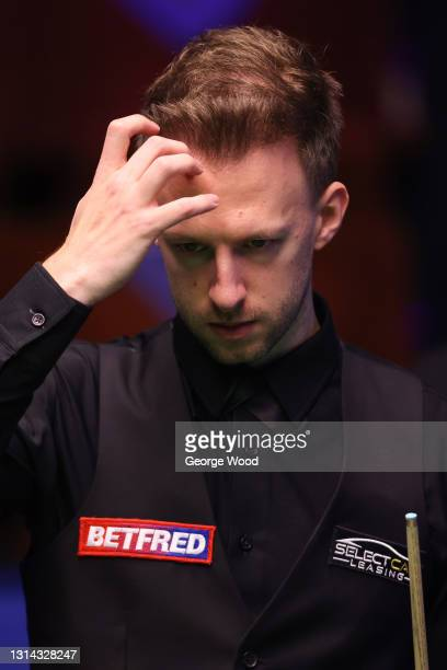 Judd Trump of England reacts during the Betfred World Snooker Championship Round Two match between David Gilbert of England and Judd Trump of England...