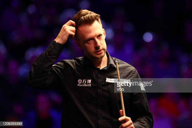 Judd Trump of England reacts during the quarterfinal match against Shaun Murphy of England on day five of the 2020 ManBetX Welsh Open at the...