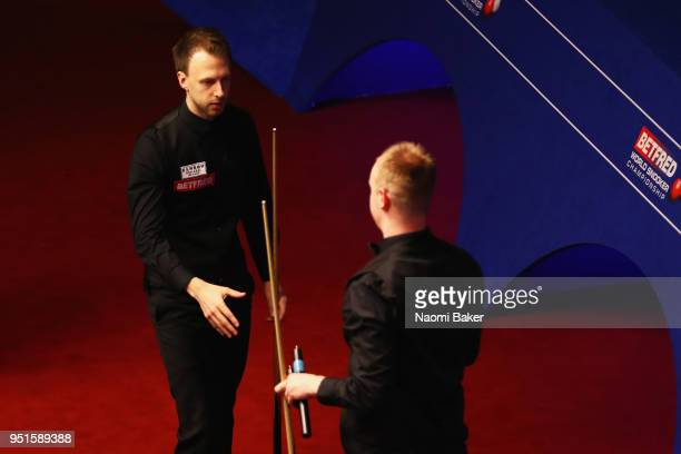 Judd Trump of England shakes hands after winning his first round match against Chris Wakelin of England during day six of the World Snooker...