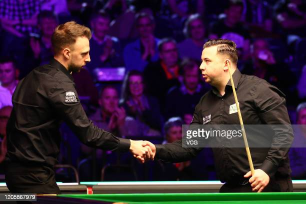 Judd Trump of England shakes hands with Billy Joe Castle of England after their 2nd round match on day three of the 2020 ManBetX Welsh Open at the...