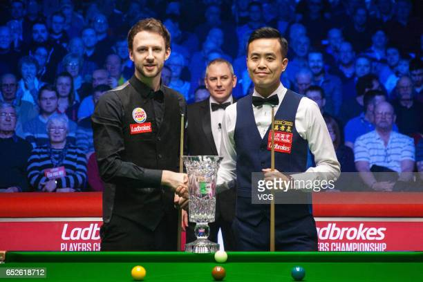 Judd Trump of England shakes hands with Marco Fu of Chinese Hong Kong during the final match on day seven of 2017 Ladbrokes Players Championship at...