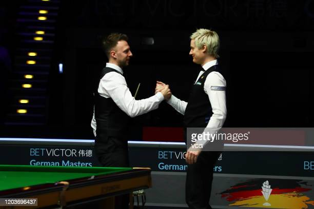 Judd Trump of England shakes hands with Neil Robertson of Australia after their final match on day five of the German Masters 2020 at the Tempodrom...