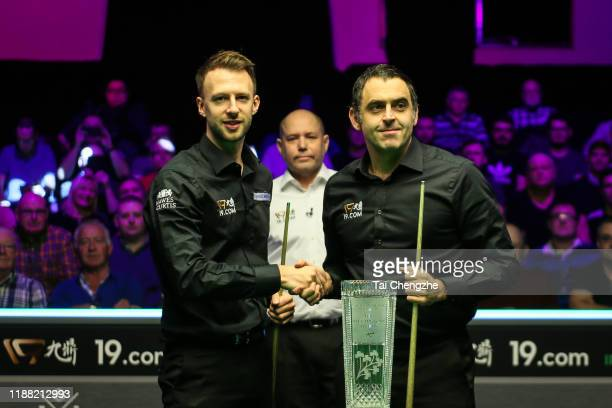 Judd Trump of England shakes hands with Ronnie O'Sullivan of England prior to their final match on day seven of 2019 Northern Ireland Open at...