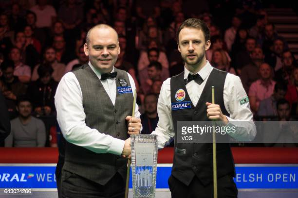 Judd Trump of England shakes hands with Stuart Bingham of England in the final match on day seven of 2017 Coral Welsh Open at the Motorpoint Arena on...