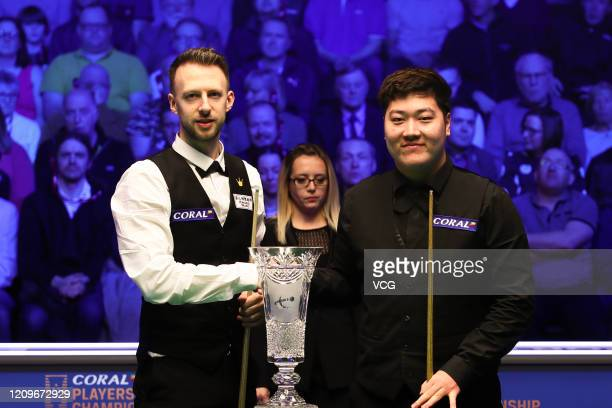 Judd Trump of England shakes hands with Yan Bingtao of China prior to their final match on day seven of 2020 Coral Players Championship at Southport...