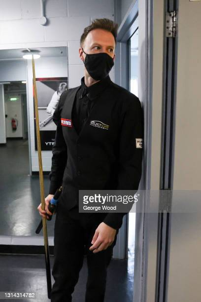 Judd Trump of England wears a face mask as he waits to walk out to the table prior to the Betfred World Snooker Championship Round Two match between...