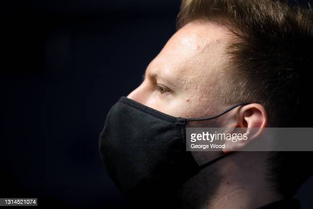 Judd Trump of England wears a face mask before entering the table during the Betfred World Snooker Championship Round Two match between David Gilbert...