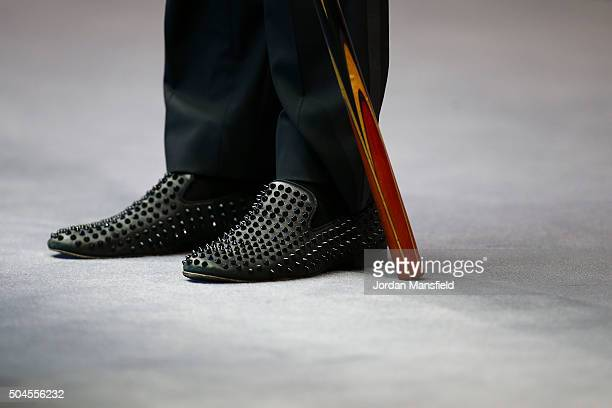 Judd Trump of England's shoes in his first round match against Stephen Maguire of Scotland during Day Two of the Dafabet Masters at Alexandra Palace...