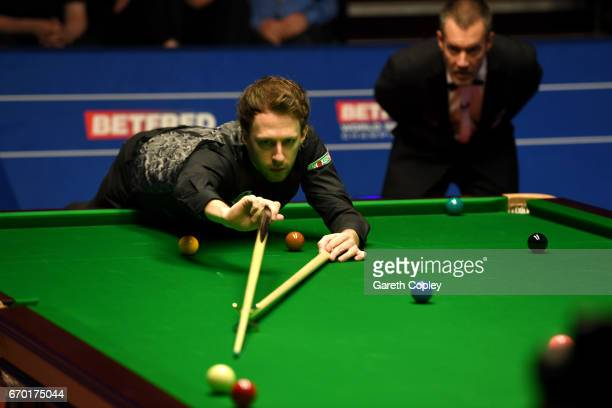 Judd Trump plays a shot against Rory McLeod during their first round match of the World Snooker Championship at Crucible Theatre on April 19 2017 in...