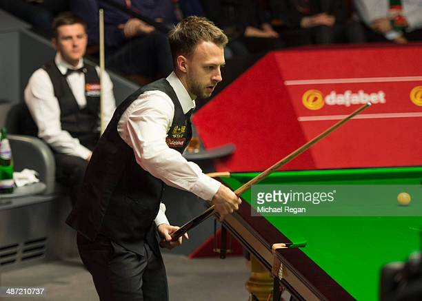Judd Trump plays a shot against Ryan Day during their second round match in The Dafabet World Snooker Championship at the Crucible Theatre on April...