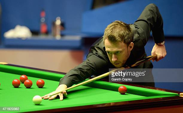 Judd Trump plays a shot against Stuart Bingham during their semi final on day fifteen of the 2015 Betfred World Snooker Championship at Crucible...