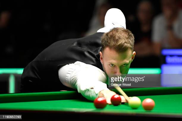 Judd Trump plays a shot during his match against Amine Amiri on day 3 of the Betway UK Championship at The Barbican on November 28, 2019 in York,...
