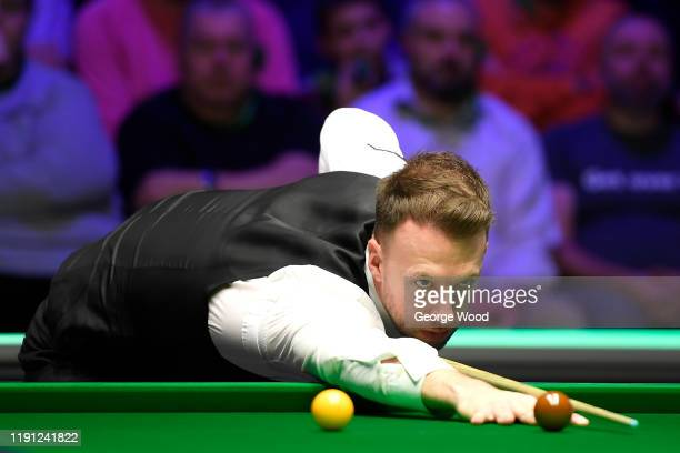 Judd Trump plays a shot during his match against Mei Xi Wen in round 2 of the Betway UK Championship at The Barbican on December 01, 2019 in York,...