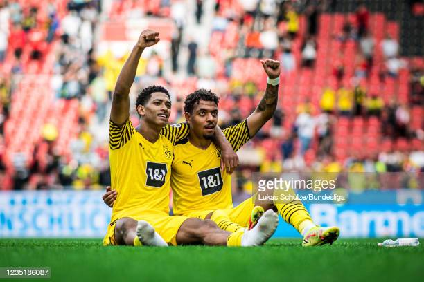 Jude Bellingham and Donyell Malen of Dortmund celebrate their win after the Bundesliga match between Bayer 04 Leverkusen and Borussia Dortmund at...