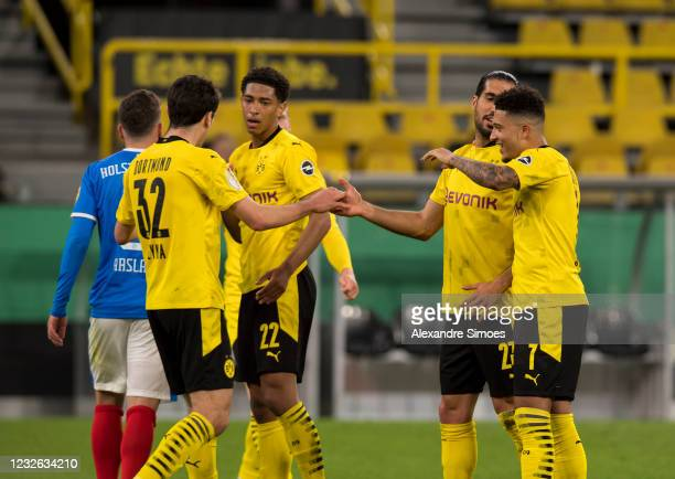 Jude Bellingham, Giovanni Reyna, Jadon Sancho and Emre Can celebrate their fifth goal during the match between Borussia Dortmund and Holstein Kiel on...