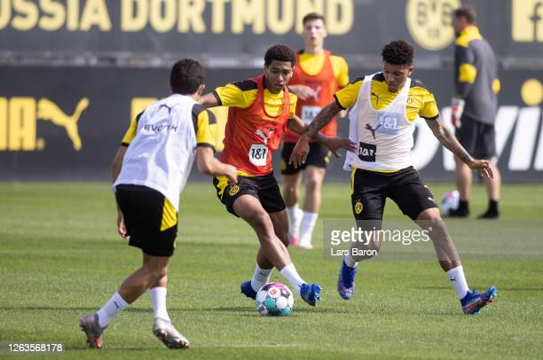 Jude Bellingham is challenged by Jadon Sancho during the first training session after the summer break on August 03 2020 in Dortmund Germany