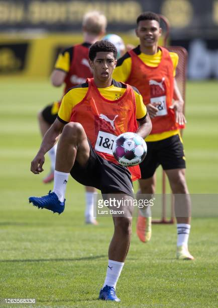 Jude Bellingham kicks the ball during the first training session of Borussia Dortmund after the summer break on August 03 2020 in Dortmund Germany