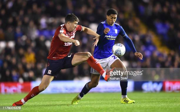 Jude Bellingham of Birmingham and Paddy McNair of Middlesbrough battle for the ball during the Sky Bet Championship match between Birmingham City and...