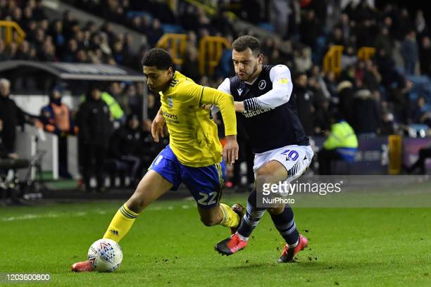 Jude Bellingham of Birmingham battles for possession with Mason Bennett of Millwall during the Sky Bet Championship match between Millwall and...