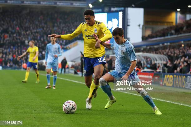 Jude Bellingham of Birmingham City and Liam Walsh of Coventry City during the FA Cup Fourth Round match between Coventry City and Birmingham City at...
