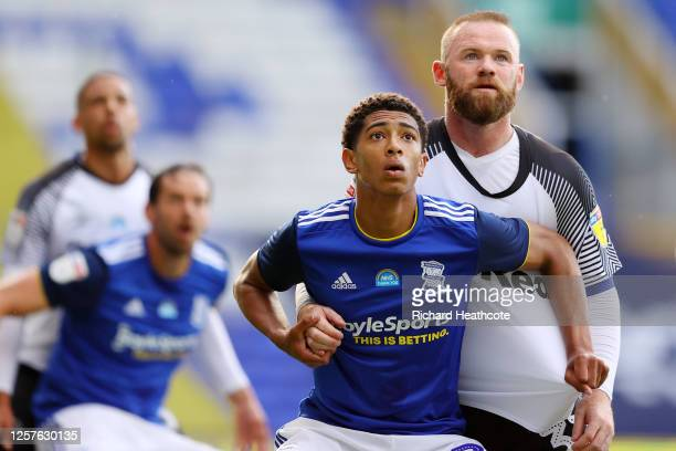 Jude Bellingham of Birmingham City and Wayne Rooney of Derby County during the Sky Bet Championship match between Birmingham City and Derby County at...