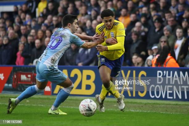 Jude Bellingham of Birmingham City in action with Liam Walsh of Coventry City during the FA Cup Fourth Round match between Coventry City and...