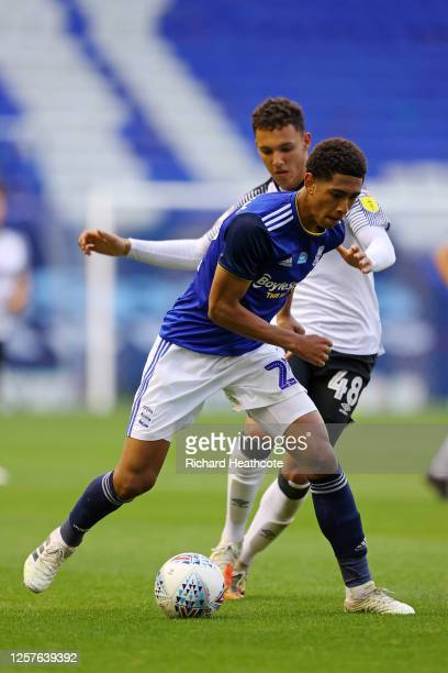 Jude Bellingham of Birmingham City is challenged by Lee Buchanan of Derby County during the Sky Bet Championship match between Birmingham City and...