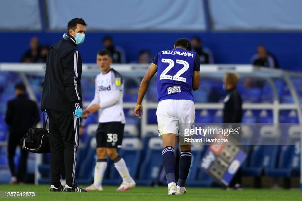 Jude Bellingham of Birmingham City is escorted off the field by medical staff during the Sky Bet Championship match between Birmingham City and Derby...