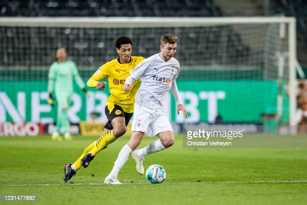 Jude Bellingham of Borussia Dortmund and Christoph Kramer of Borussia Moenchengladbach battle for the ball during the DFB Cup Quarter Final match...