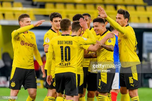 Jude Bellingham of Borussia Dortmund celebrates after scoring his team's fifth goal with teammates during the DFB Cup semi final match between...