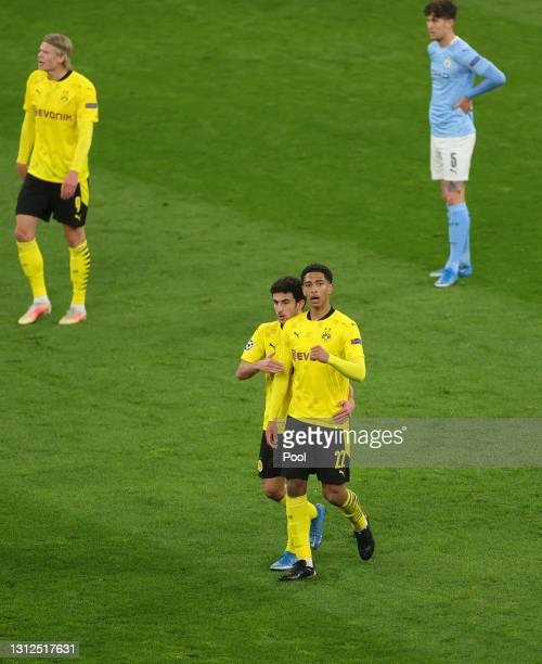 Jude Bellingham of Borussia Dortmund celebrates after scoring their side's first goal during the UEFA Champions League Quarter Final Second Leg match...