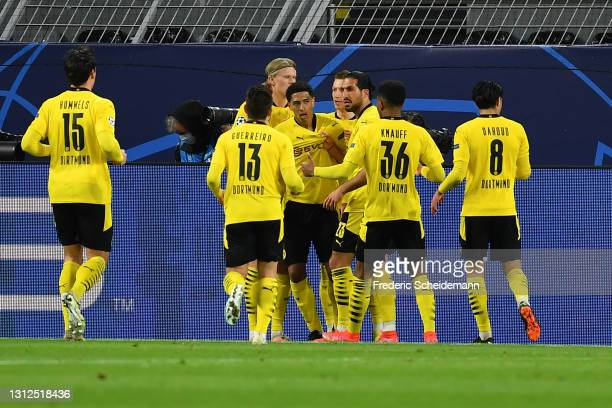 Jude Bellingham of Borussia Dortmund celebrates with Erling Haaland, Emre Can and team mates after scoring their side's first goal during the UEFA...