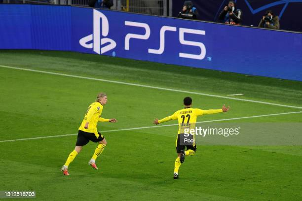 Jude Bellingham of Borussia Dortmund celebrates with team mate Erling Haaland after scoring their side's first goal during the UEFA Champions League...