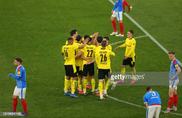 Jude Bellingham of Borussia Dortmund celebrates with team mates after scoring their side's fifth goal during the DFB Cup semi final match between...