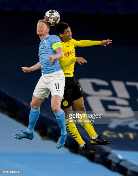 Jude Bellingham of Borussia Dortmund in action against Kevin De Bruyne of Manchester City during the Champions League match between Manchester City...