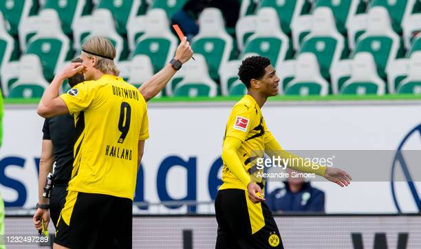 Jude Bellingham of Borussia Dortmund is leaving the pitch after receiving the yellow-red card during the Bundesliga match between VfL Wolfsburg and...