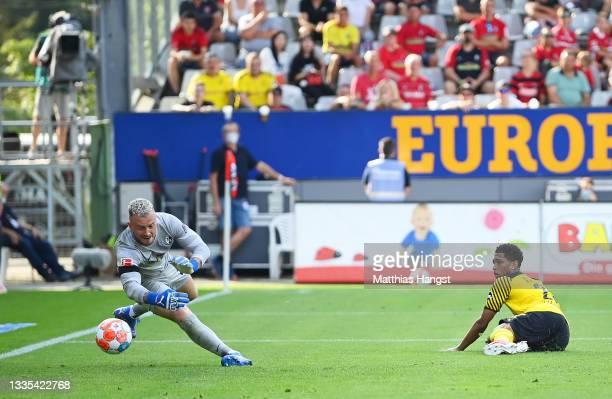 Jude Bellingham of Borussia Dortmund looks on after their side's first goal, an own goal scored by Yannik Keitel past Mark Flekken of SC Freiburg...