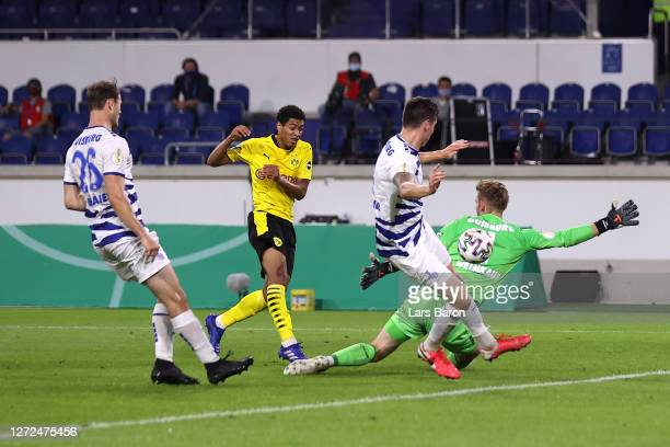 Jude Bellingham of Borussia Dortmund scores his sides second goal during the DFB Cup first round match between MSV Duisburg and Borussia Dortmund at...