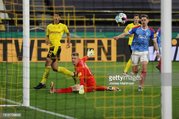 Jude Bellingham of Borussia Dortmund shoots and misses during the DFB Cup semi final match between Borussia Dortmund and Holstein Kiel at Signal...