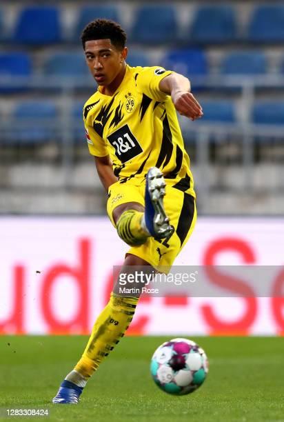 Jude Bellingham of Dortmund runs with the ball during the Bundesliga match between DSC Arminia Bielefeld and Borussia Dortmund at Schueco Arena on...