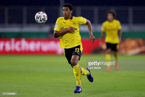 Jude Bellingham of Dortmund runs with the ball during the DFB Cup first round match between MSV Duisburg and Borussia Dortmund at...