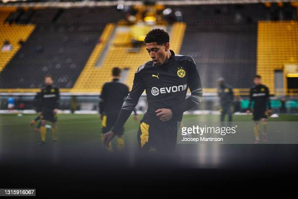 Jude Bellingham of Dortmund warms up ahead of the DFB Cup semi final match between Borussia Dortmund and Holstein Kiel at Signal Iduna Park on May...