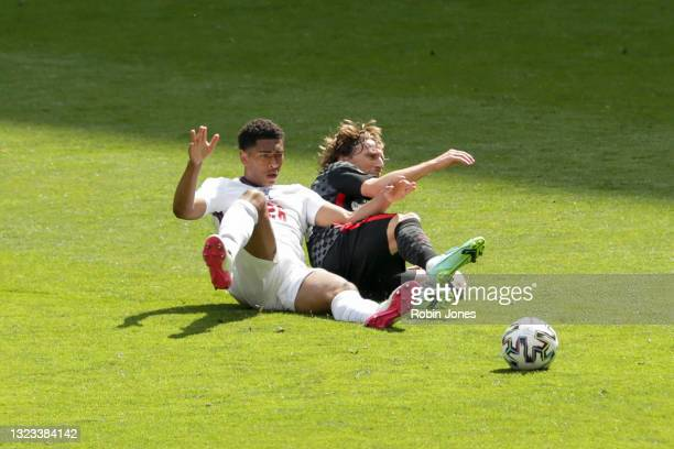 Jude Bellingham of England and Luka Modric of Croatia slide in for the ball during the UEFA Euro 2020 Championship Group D match between England and...