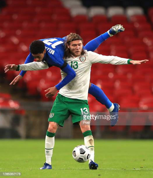 Jude Bellingham of England collides with Jeff Hendrick of Republic of Ireland during the international friendly match between England and the...