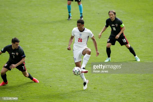 Jude Bellingham of England gets between Josip Brekalo and Luka Modric of Croatia during the UEFA Euro 2020 Championship Group D match between England...