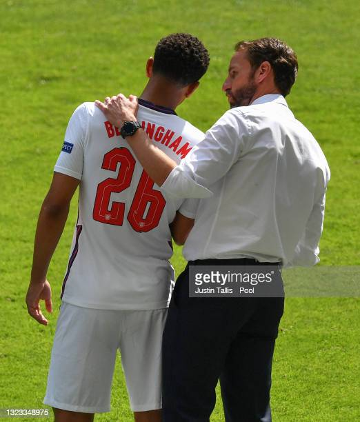 Jude Bellingham of England interacts with Gareth Southgate, Head Coach of England as he is substituted during the UEFA Euro 2020 Championship Group D...